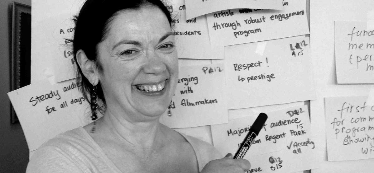 Gail Picco in front of white board