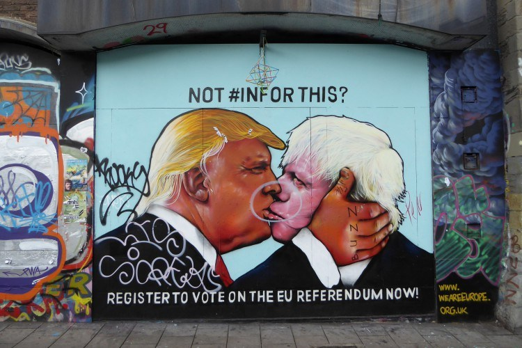 A mural of Donald Trump and Boris Johnson kissing with the words 'Not #InFor this? Vote IN 23rd June'