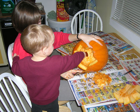 Lego scooping out the pumpkin