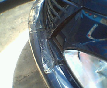 Cracked bumper and headlight