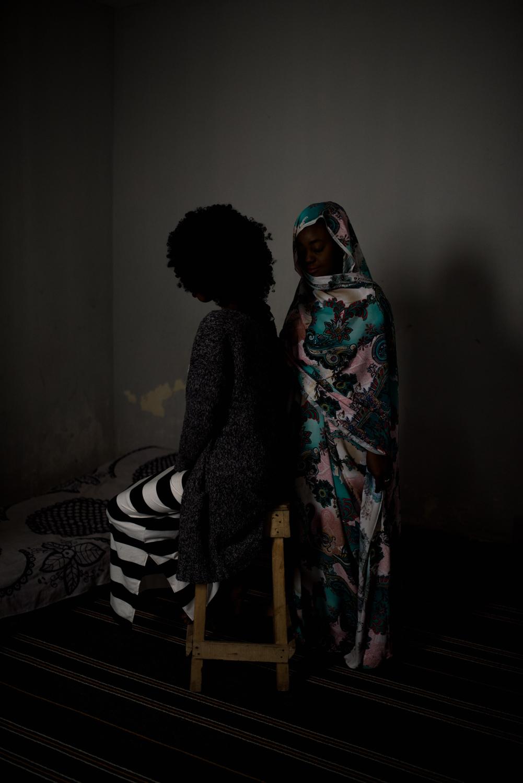 Portrait of Aïcha (on the right of the picture) and Bambi, a distant cousin, both lesbians, they often meet to share their stories and support each other. Nouakchott-Mauritania.Portrait de Aïcha (à droite de l'image) et Bambi, cousine lointaine, toutes les deux lesbiennes, elles se retrouvent souvent pour partager leurs histoires et se soutenir mutuellement.