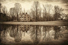 """The Old Manse Photograph on canvas 20"""" x 30"""" $235.00 The Old Manse, a National Historic Landmark located in Concord, Massachusetts. One of Concord's most famous old houses. Built in 1770 by Reverend William Emerson, the house was relatively new when, on the morning of April 19, 1775, British redcoats marched past it and across the famous North Bridge on their way to Colonel Barrett's farm. The British soldiers were looking to destroy colonial militia arms caches. The first official military conflict of the American Revolution erupted about a half a mile away from the Old Manse on the North Bridge. The bridge can be seen from the house's top floors."""