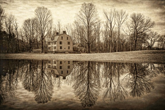 """James Correia The Old Manse Photograph on canvas 20"""" x 30"""" $235.00 The Old Manse, a National Historic Landmark located in Concord, Massachusetts. One of Concord's most famous old houses. Built in 1770 by Reverend William Emerson, the house was relatively new when, on the morning of April 19, 1775, British redcoats marched past it and across the famous North Bridge on their way to Colonel Barrett's farm. The British soldiers were looking to destroy colonial militia arms caches. The first official military conflict of the American Revolution erupted about a half a mile away from the Old Manse on the North Bridge. The bridge can be seen from the house's top floors."""