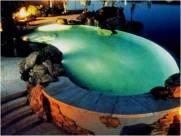 Designed Jacuzzi with waterfall on rockery and lighting effects