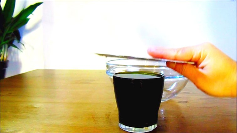 Step 2: Setting up of the upside  down water experiment. Make sure you have the right thick card. Paper won't do.