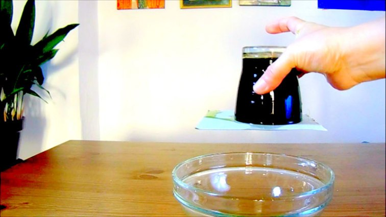 Step 4: and the magic happens. The upside down glass of water in a cup or glass.