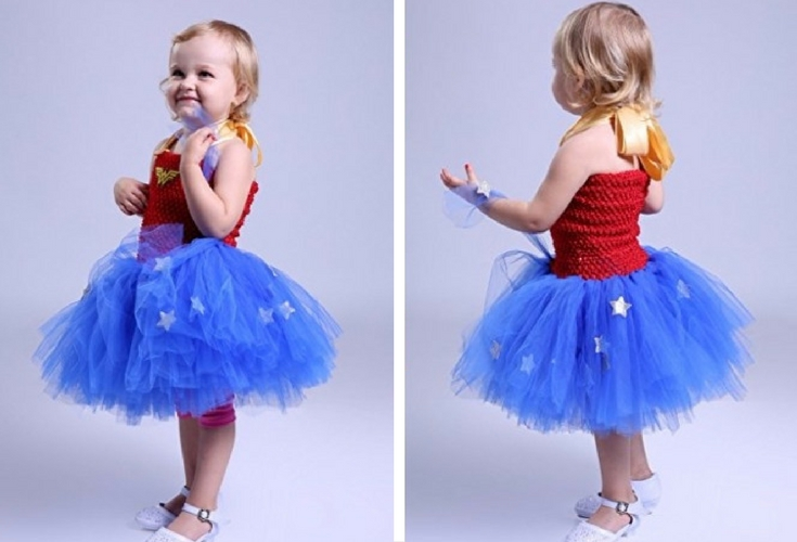 A cute blue tutu with stars with a red top and the Wonder Woman logo in the front. One of the best Wonder Woman costumes for toddlers.