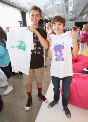 CULVER CITY, CA - JUNE 22:  In this photo provided by Nintendo of America, kids show their custom Kirby t-shirts at the Kirby: Planet Robobot celebration at Smashbox Studios in Culver City, California, on June 22, 2016. In the new sci-fi adventure game, available now for the Nintendo 3DS family of systems, Kirby has the power to save his world from enemies with his mechanized Robobot Armor.  (Photo by Jonathan Leibson/Getty Images for Nintendo of America)