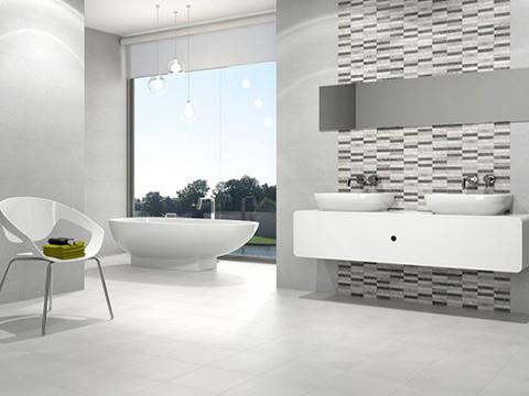 Tendencias cerámicas con baño en tonos blancos y grises.