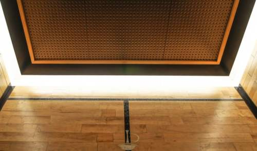 Elevator #5 side opening doors, brass COP panel, suspended perforated painted steel (painted) ceiling, bronze trim, wood border and perimeter lights, reclaimed wood floors refurbished as upper elevator wall panels at Chicago Athletic Association Hotel CAA by G&R Custom Cabs
