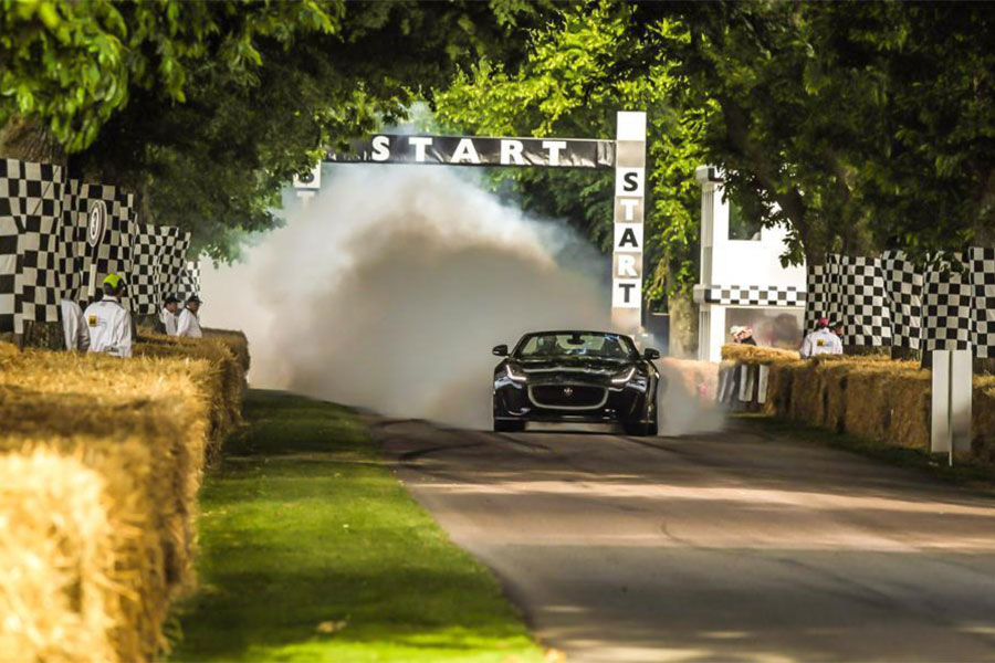 An image of cars racing at the Goodwood Festival of Speed - book a chauffeur to this event from GandT Executive