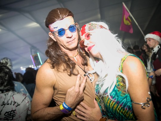 This couple enjoyed some hippie vibes during Decadence at Rawhide Western Town in Chandler on Sunday, December 31, 2017.