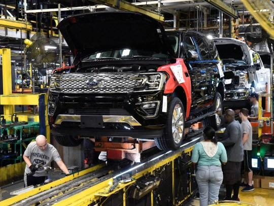 UAW members are concerned about security during the pandemic. Here, workers assemble Ford trucks at the Ford Kentucky truck plant in Louisville, Kentucky in October 2017.