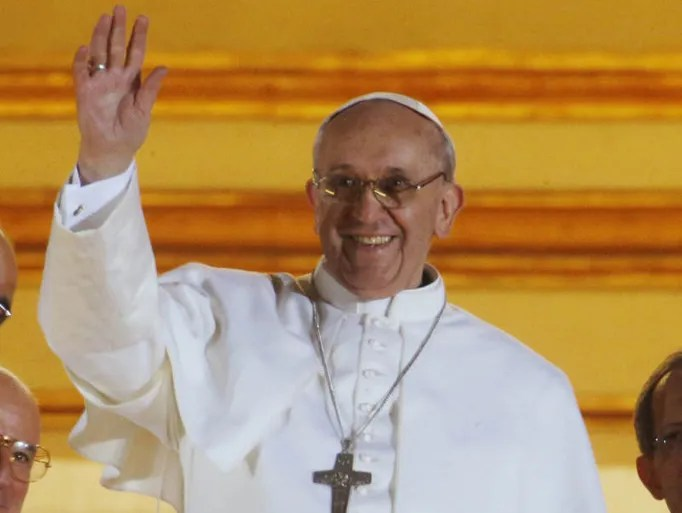 Pope Francis waves to the crowd from the central balcony of St. Peter's Basilica at the Vatican, Wednesday, March 13, 2013. Cardinal Jorge Bergoglio, who chose the name of Francis is the 266th pontiff of the Roman Catholic Church.  (AP Photo/Dmitry Lovetsky)