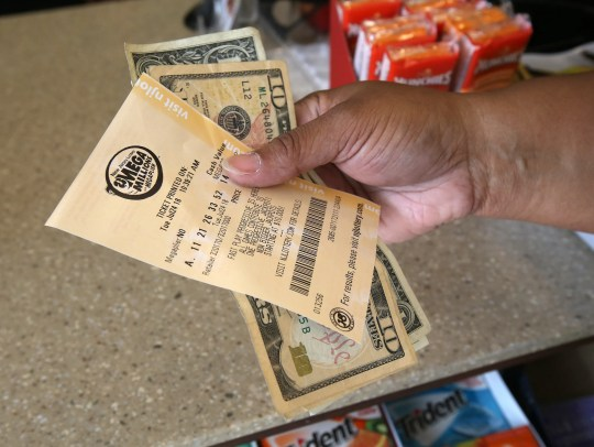 Sharisse Martin of Long Branch purchases Mega MIllions lottery tickets at Krauser's Food Stores and Blimpie, located at The Waverly, in Neptune, NJ Tuesday July 24, 2018.