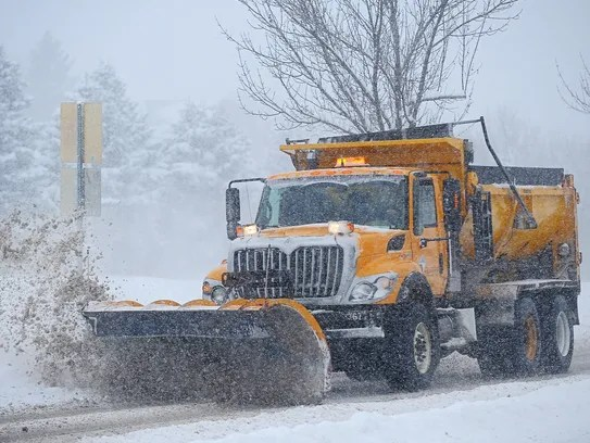 A City of Sioux Falls Public Works plow clears snow