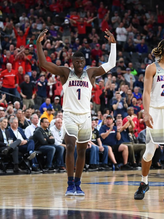 Mar 8, 2018; Las Vegas, NV, USA; Arizona Wildcats center Dusan Ristic (14) and guard Rawle Alkins (1) gesture to the crowd during a quarterfinals match against the Colorado Buffaloes in the Pac-12 Tournament at T-Mobile Arena. Mandatory Credit: Stephen R. Sylvanie-USA TODAY Sports