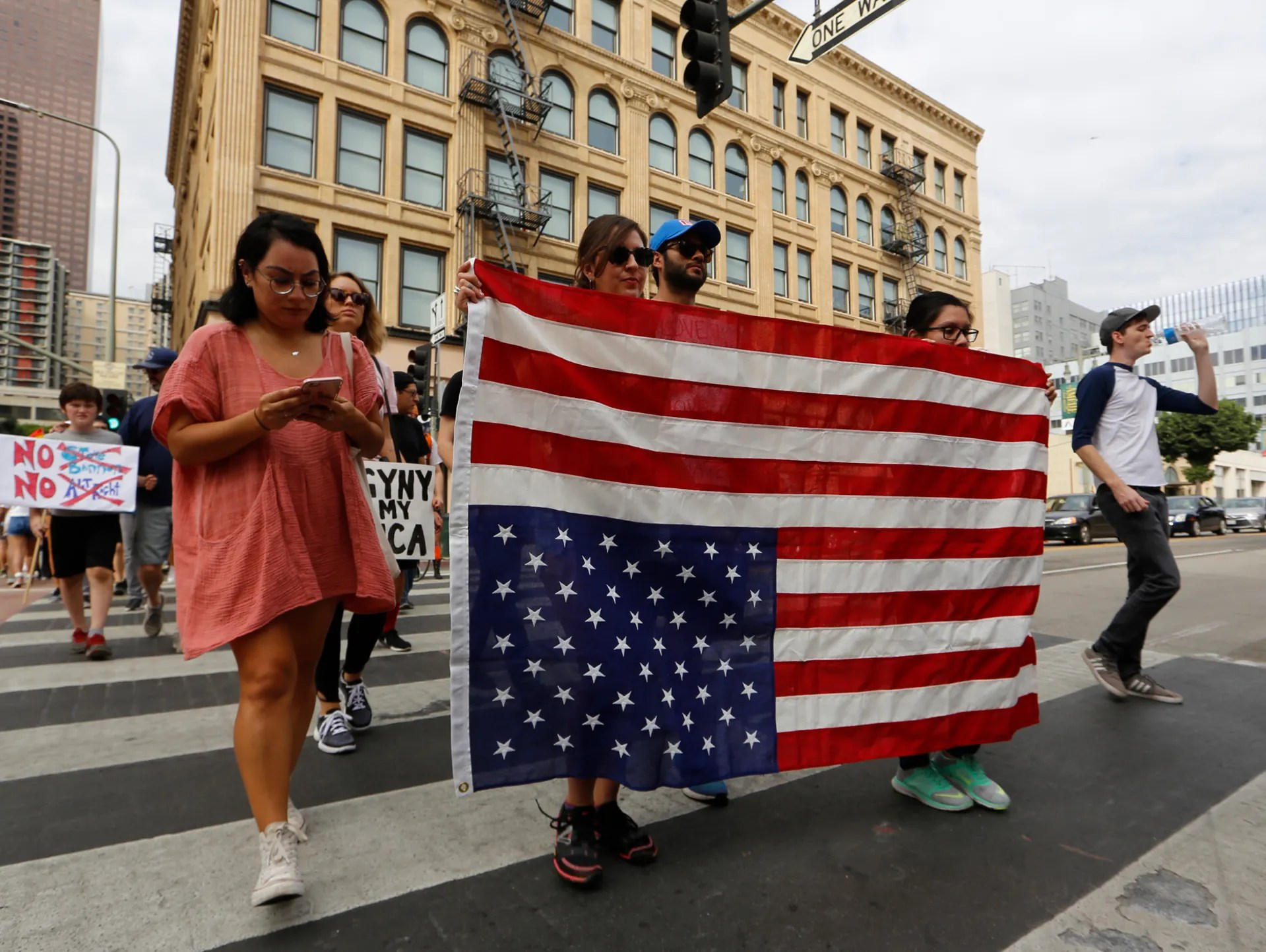 Anti-Trump demonstrators hold a U.S. flag upside-down