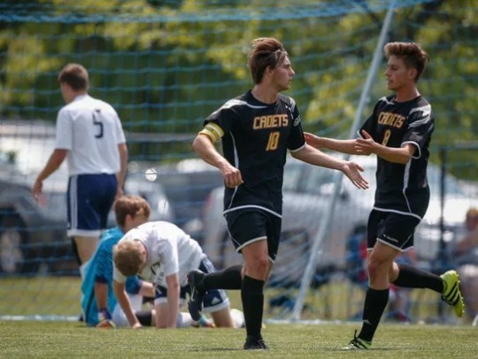 Iowa Falls-Alden senior Marcos Vila, left, celebrates