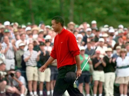 At the 18th hole, Tiger Woods acknowledges the gallery