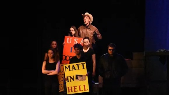 Keegan Luther as the Rev. Fred Phelps in Greasepaint