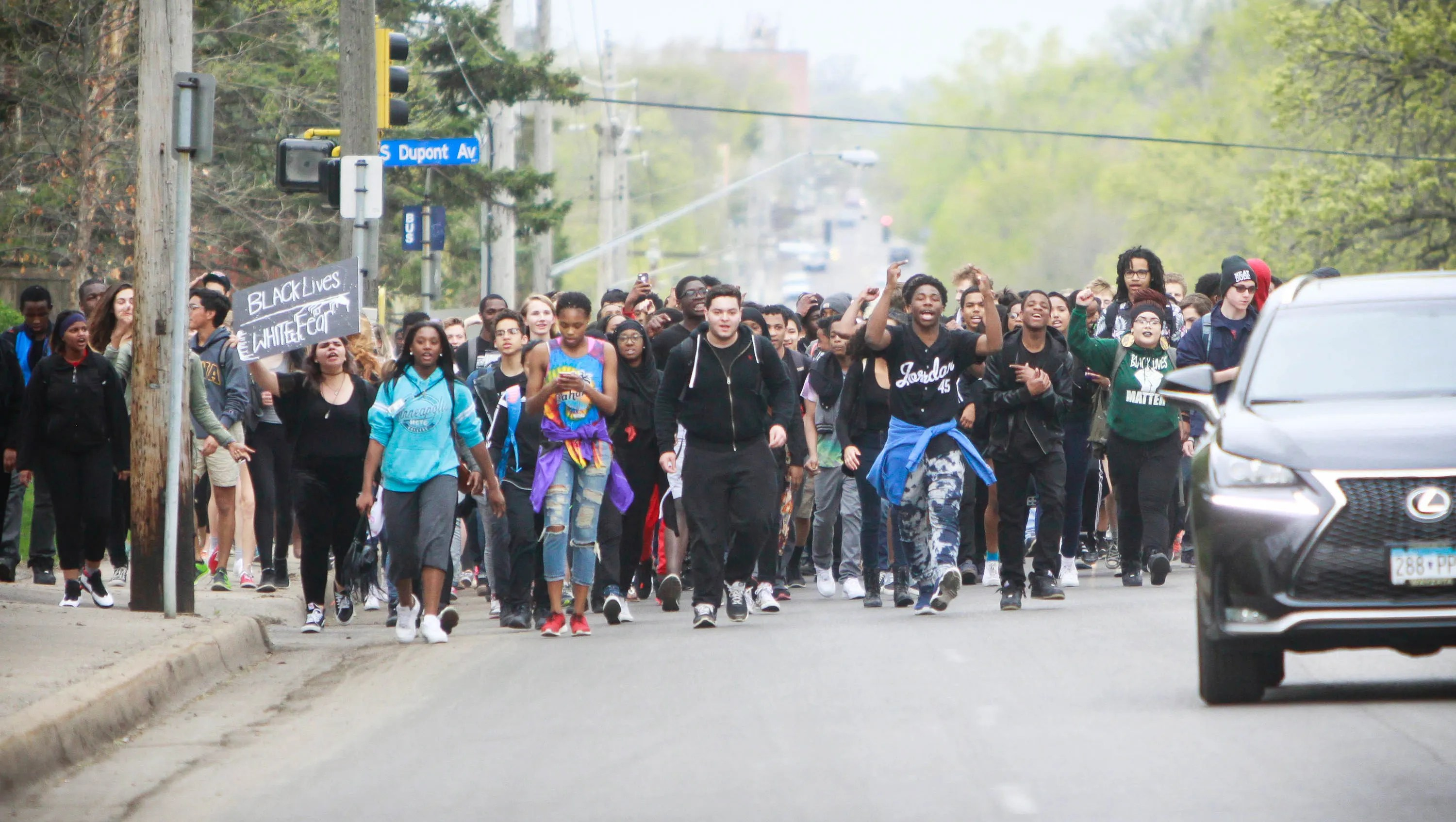 Students from Southwest High School march to join with other students who walked out of school to participate in a Black Lives Matter rally at Martin Luther King Jr. Park in Minneapolis on Friday, May 1, 2015.