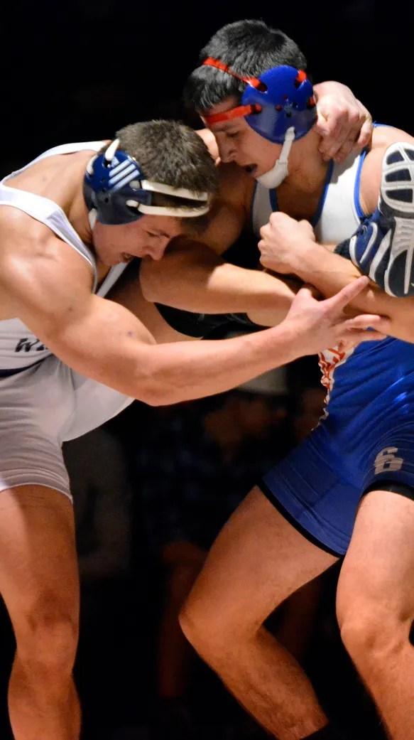 Dallastown's Hayden Jones (left) wrestles Spring Grove's