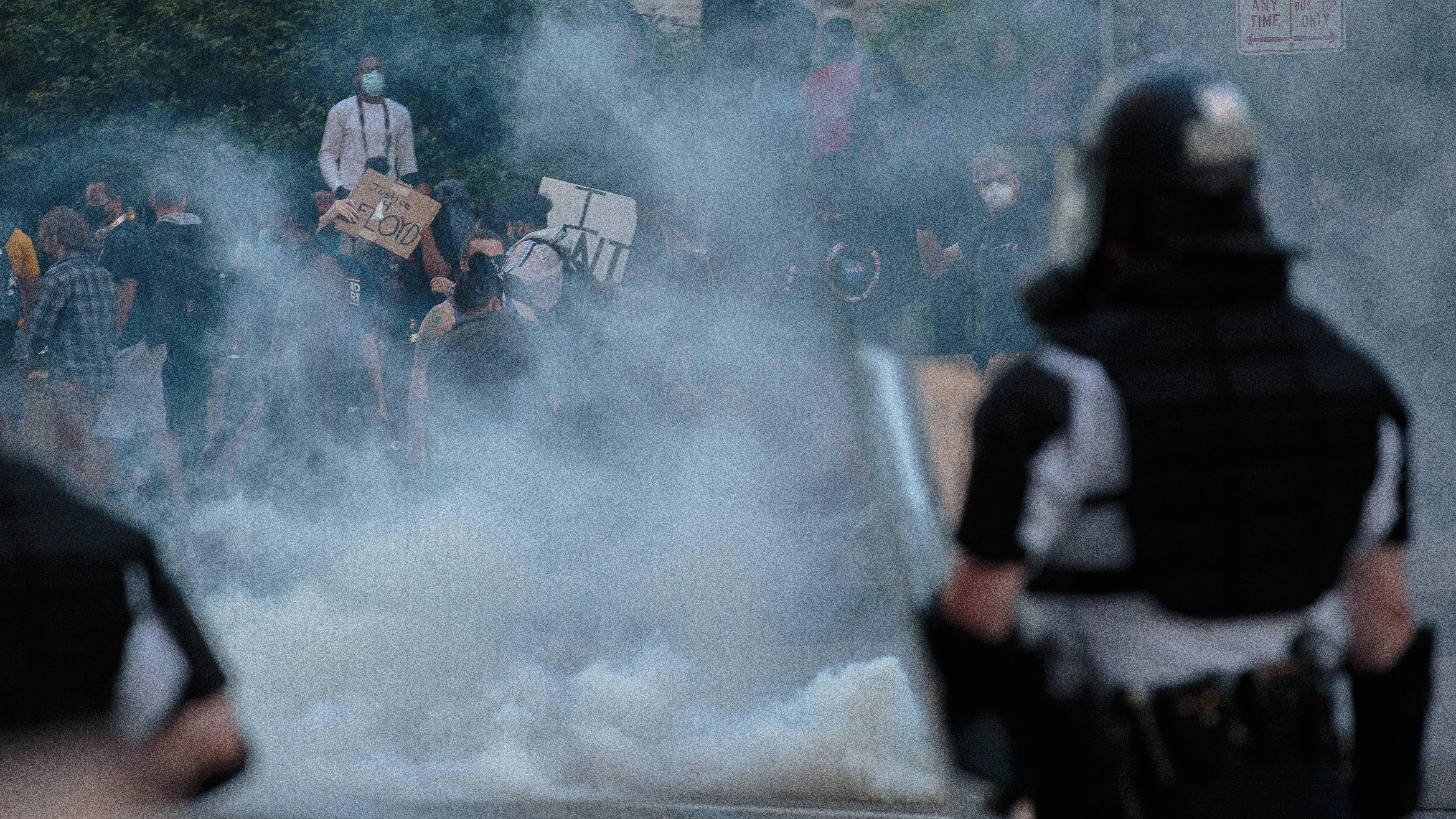 Protesters disperse Downtown after Columbus police officers deployed tear gas on May 30.