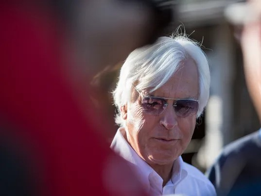 Trainer Bob Baffert answers questions following one last workout by Justify