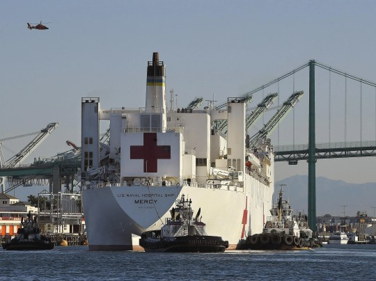 The USNS Mercy hospital ship enters the Port of Los Angeles. The number of COVID-19 cases among crewmembers of the Mercy has risen to seven while it is docked in the Port of Los Angeles to help serve the region's patients who have not been stricken by the coronavirus. A 3rd Fleet spokesman says the seven have been isolated off the ship and the Mercy's ability to receive patients has not been affected.