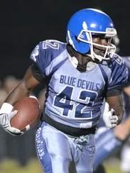 White House tailback Bryan Dixon carries the football