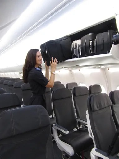Alaska Airlines flight attendant Jenn-Marie Mann shows