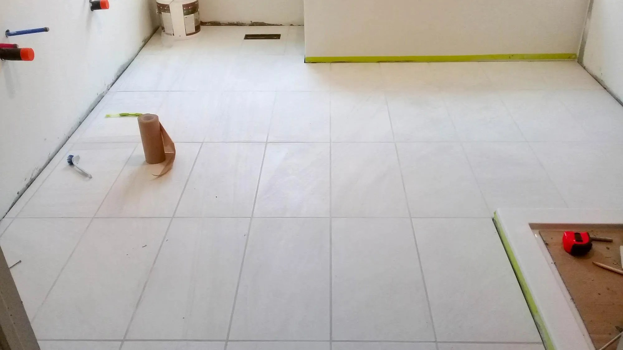 let tile grout dry fully before