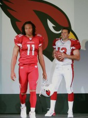 Arizona Cardinals' Larry Fitzgerald and Kurt Warner display their new uniforms Wednesday, April 20, 2005. That is the last time the Cardinals underwent a significant uniform change.