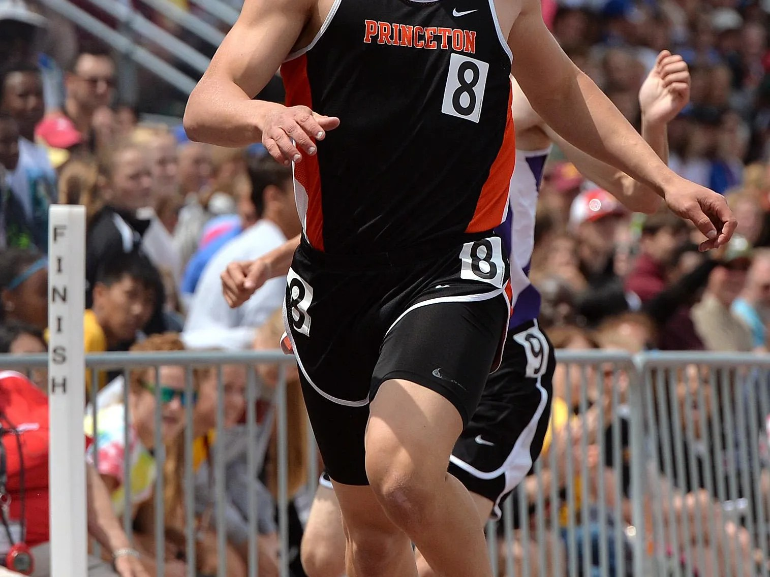Princeton senior Tanner Bowers competes in the 200-meter dash in the Class  2A state