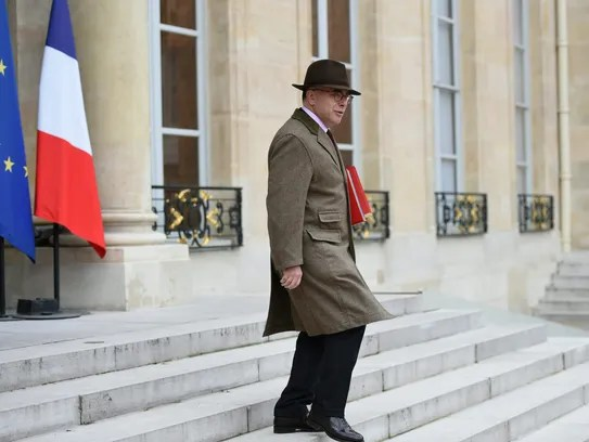 French Interior Minister Bernard Cazaneuve leaves after