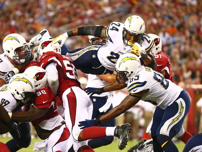 San Diego Chargers running back Ryan Mathews (24) leaps towards the end zone prior to scoring a touchdown in the first quarter against the Arizona Cardinals during a preseason game at University of Phoenix Stadium.