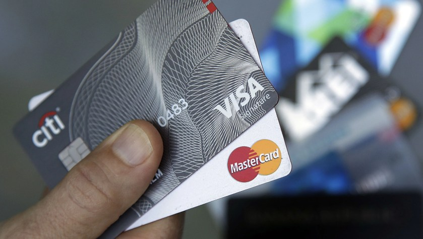 Credit cards are displayed in Haverhill, Massachusetts.  Learning that your friend has better credit than you can be a bummer, but there are ways to improve your credit.
