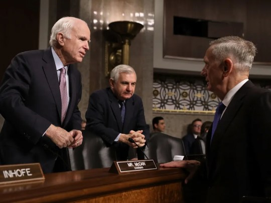 GOP Sen. John McCain of Arizona, Armed Services Committee chairman, and ranking Democrat Jack Reed of Rhode Island, visit with Secretary of Defense James Mattis on June 13, 2017, before a Capitol Hill hearing.