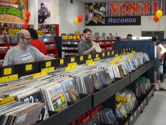 Customers shopping for vinyl at grand opening of Zia megastore in Chandler.