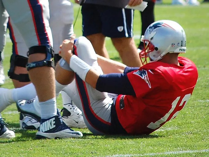 Patriots QB Tom Brady suffered an apparent left knee injury Aug. 14 when LT Nate Solder was pushed into his leg.