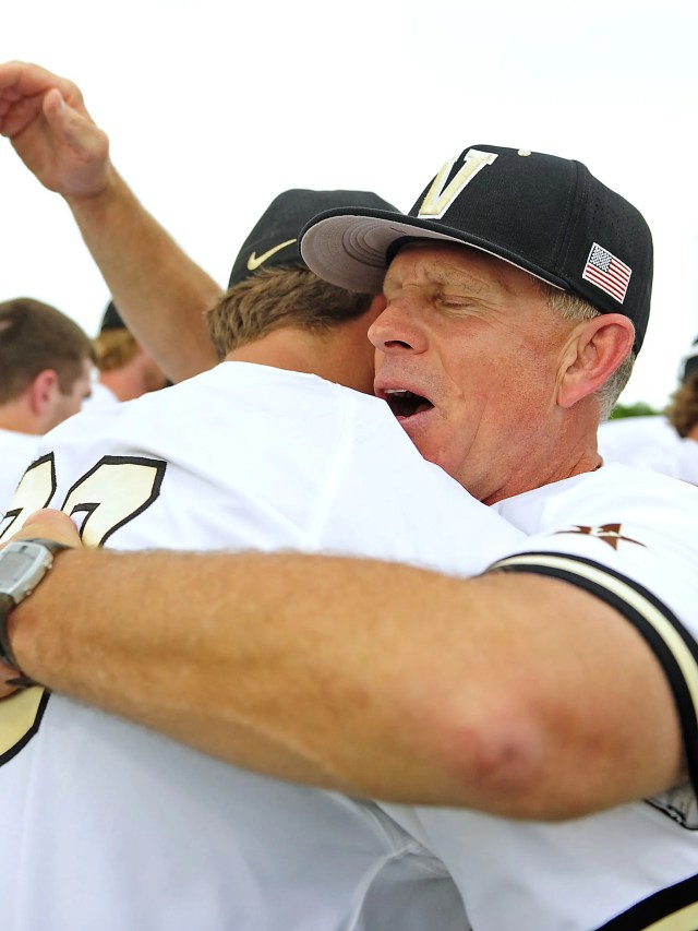 Vanderbilt coach Tim Corbin, right, hugs Matt Ruppenthal after the Commodores defeated Illinois 4-2 in the Game 2 of an NCAA Super Regional on  June 8, 2015.