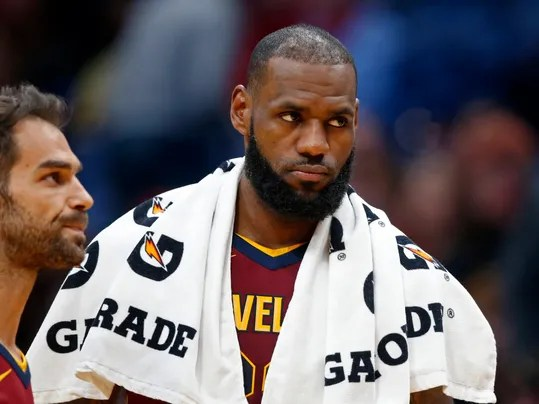 Cleveland Cavaliers forward LeBron James, right and guard Jose Calderon walk to the bench during a timeout in the second half of an NBA basketball game against the New Orleans Pelicans in New Orleans, Saturday, Oct. 28, 2017. The Pelicans won 123-101. (AP Photo/Gerald Herbert)
