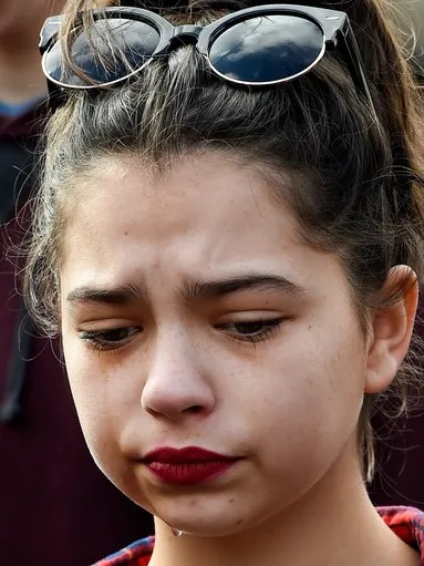 Ayla Williams 15, sheds a tear during the Silent Inauguration