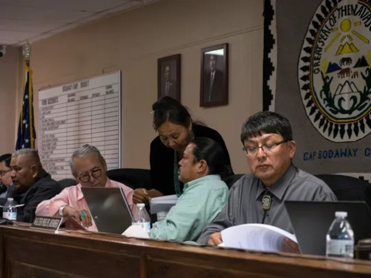 Walter Phelps (right), committee board member, reads