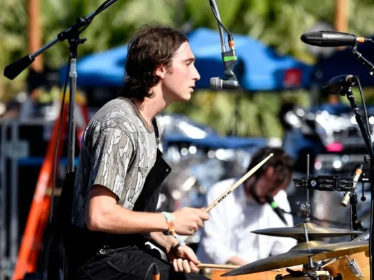 Julien Ehrlich of Whitney performs on the Outdoor Theatre