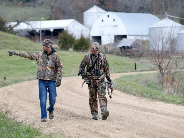 Veterans Patrick Perkins, left, and Nick Mason walk