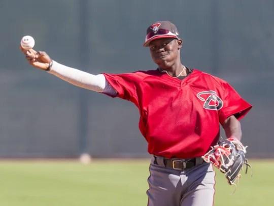 Diamondbacks prospect Jasrado Chisholm warms up at