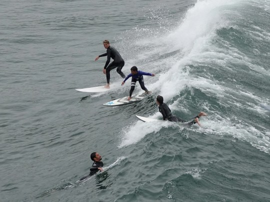 Surfing in Surf City always attracts a crowd.