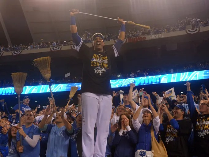 Game 3 in Kansas City - Royals 8, Angels 3: Salvador Perez celebrates with a broom to signify a sweep of the Angels.